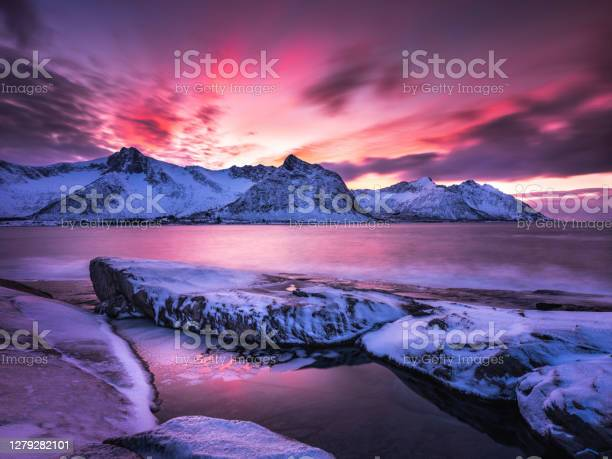 Photo of Steinfjord winter view at sunset in Senja, Norway.