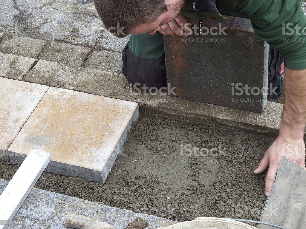Steinplatten verlegen stock photo