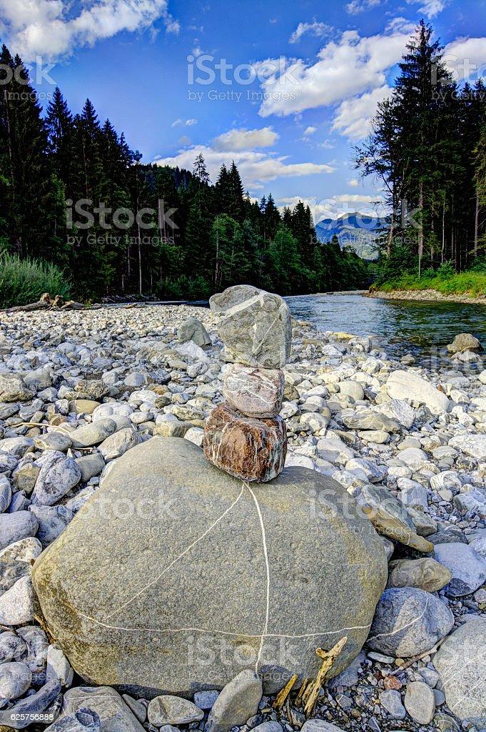 Steinturm am Bergfluss stock photo