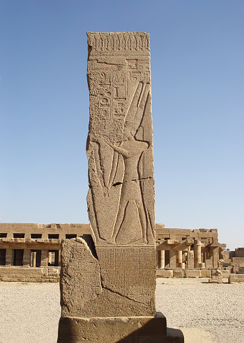 istock Stella depicting the god Amun on the background Festival Hall of Thutmose III. 653146758