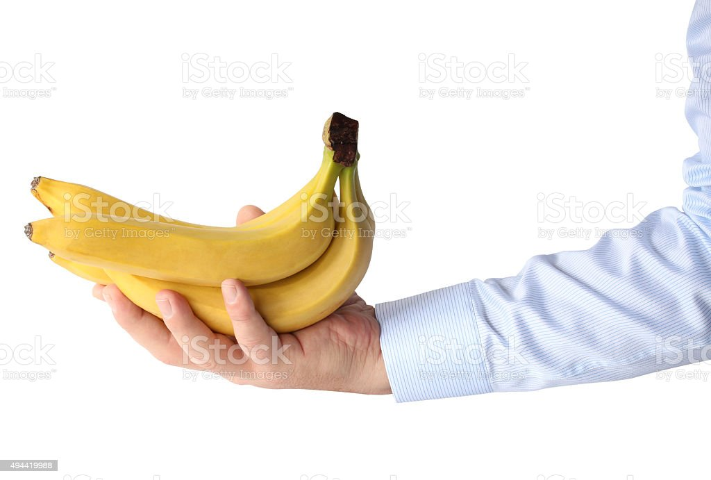 Stem of bananas in hand stock photo