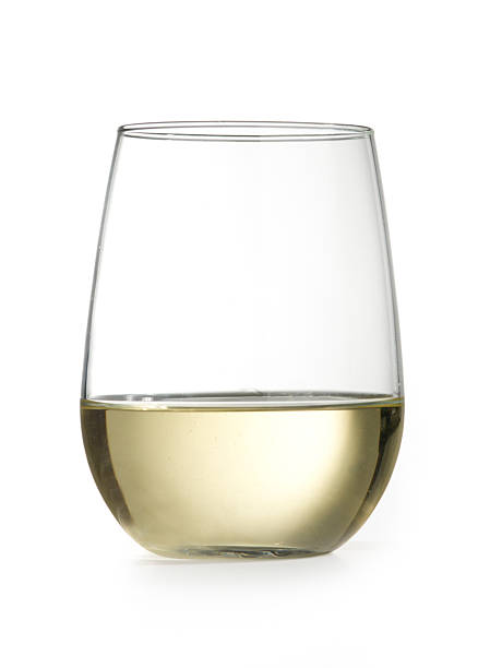 stemless wine glass with chardonnay isolated on white - wine glass stock photos and pictures