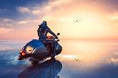 istock Stempunk biker driving through frozen fantasy landscape 511852238