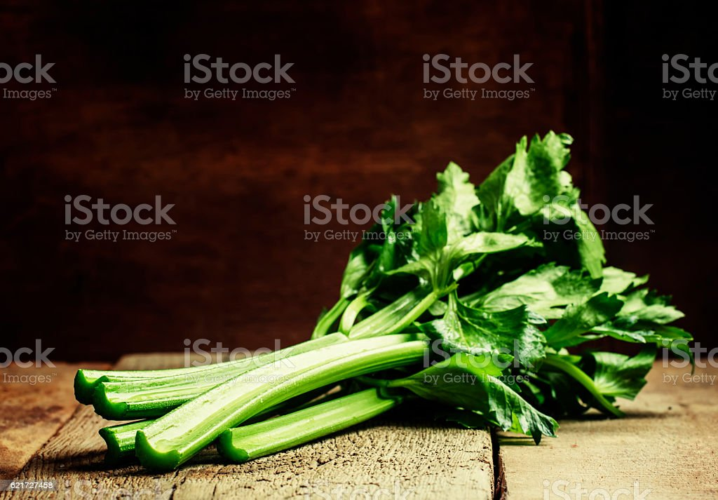 Stems of fresh celery stock photo