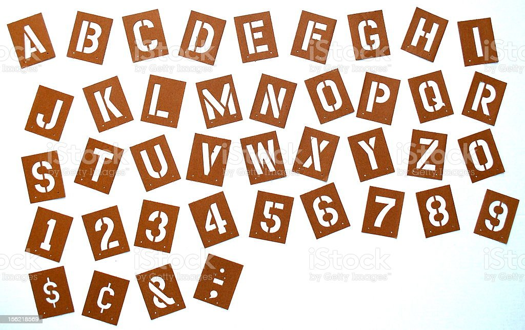 Stencil Alphabet, Numbers, and Symbols on White Background royalty-free stock photo