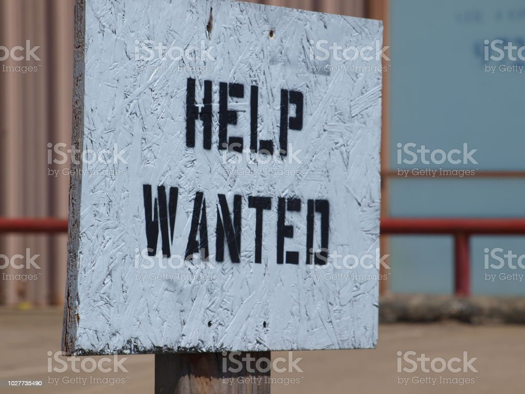 A stenciled help wanted gets job done stock photo