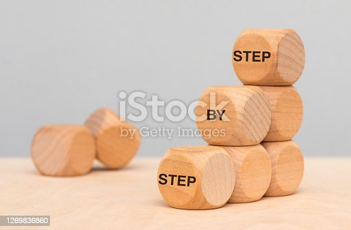 step by step printed on wooden cubes