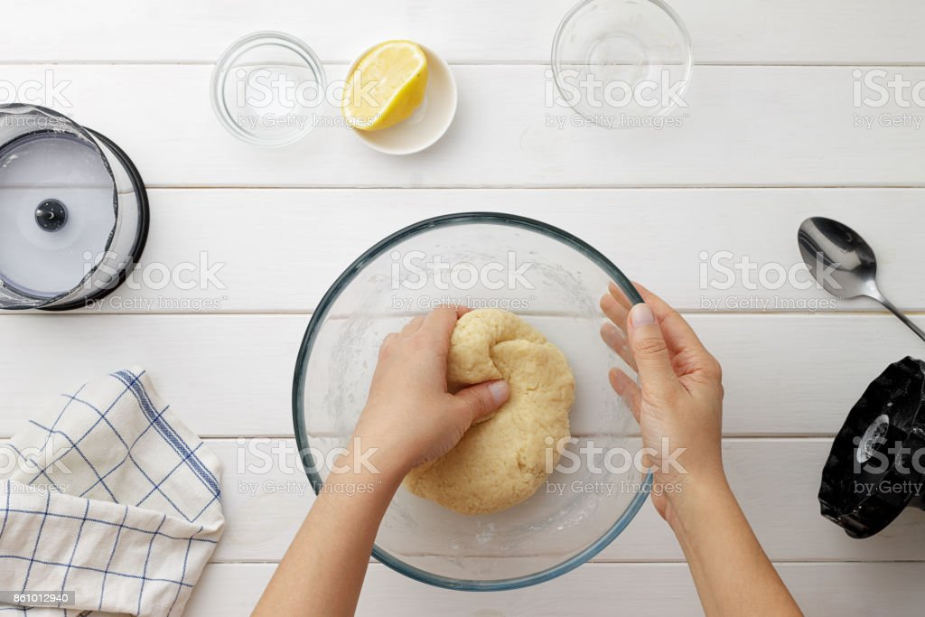 Step by step recipe galette or pie with nectarines. Female hands kneading a dough. stock photo