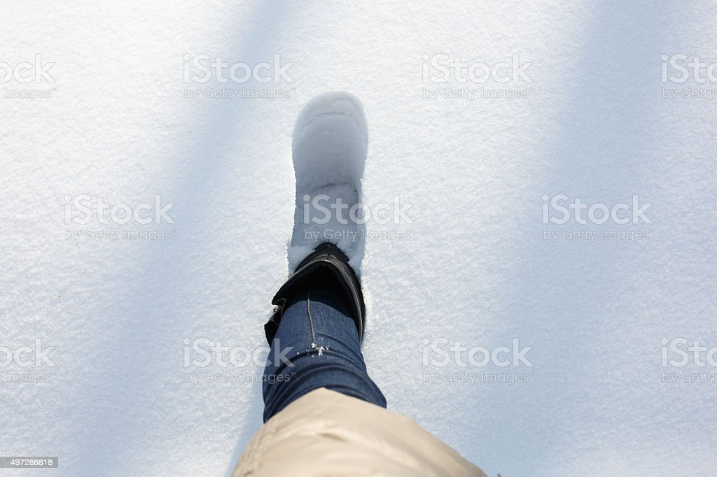 Step in a deep snow stock photo
