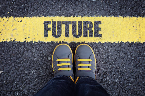 Step into the future Future line child in sneakers standing next to a yellow line stepping stock pictures, royalty-free photos & images
