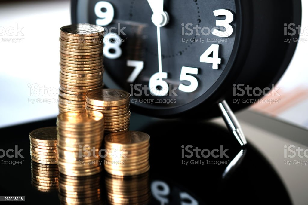 Step of coins stacks and alarm clock with tablet computer and financial graph, business planning vision and finance analysis concept. zbiór zdjęć royalty-free