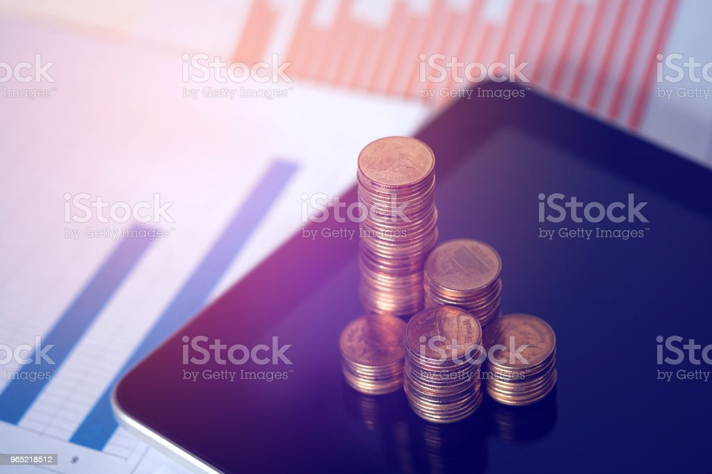 Step of coins stacks and tablet computer with financial graph, business planning vision and finance analysis concept. zbiór zdjęć royalty-free