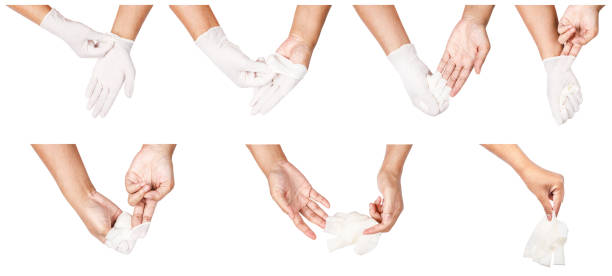 Step of hand throwing away white disposable gloves medical stock photo