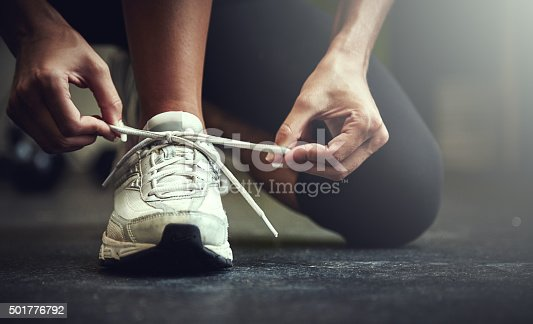 Cropped shot of a young woman tying her shoelaceshttp://195.154.178.81/DATA/i_collage/pu/shoots/806123.jpg