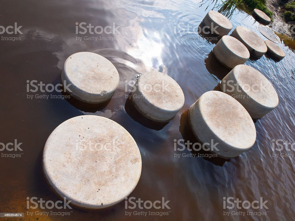 Step stones in water stock photo