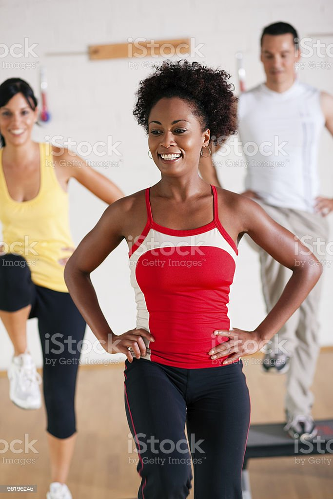 Step Training in gym with instructor royalty-free stock photo