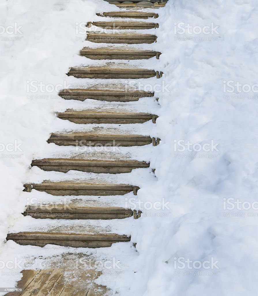 step with snow cover stock photo