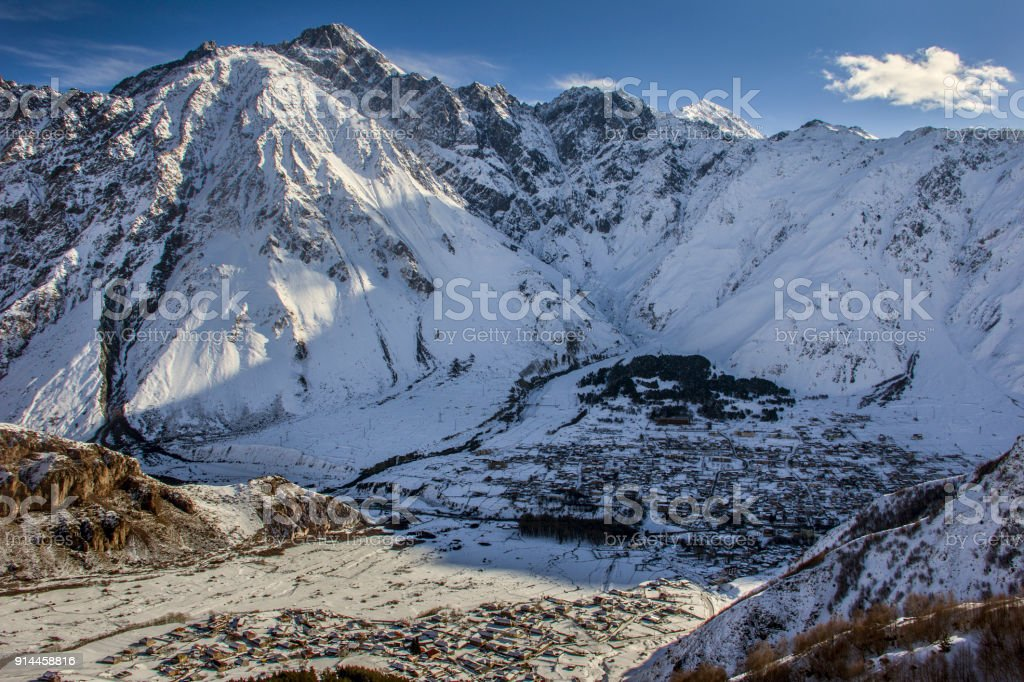 Stepantsminda (Kazbegi) and Gergetti are two settlements located in the highland part of Georgia, near the border with Russia. stock photo