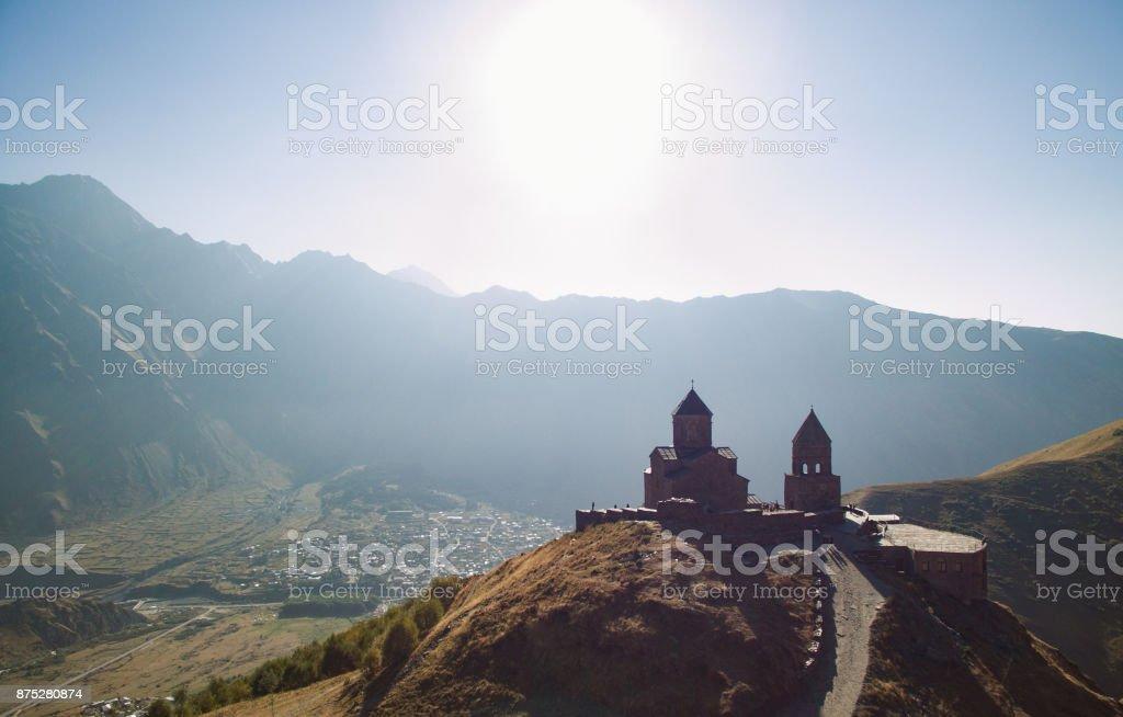 Stepantsminda church on the mountain. stock photo