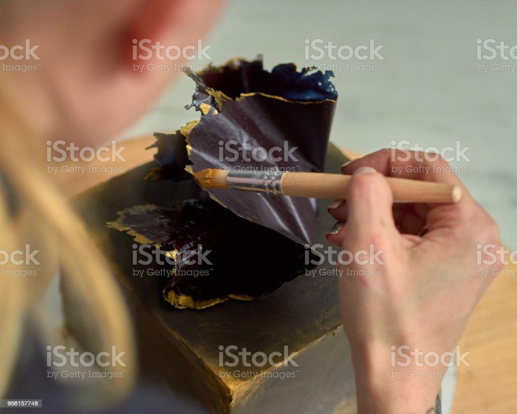 Step-by-step preparation of black designer cake. The confectioner...