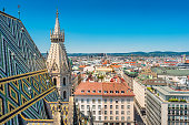 Stock photograph of Stephansdom aka St. Stephen's Cathedral and cityscape of downtown Vienna Austria on a clear sunny day.