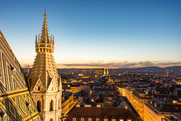 Stephansdom cathedral and aerial view over Vienna at night