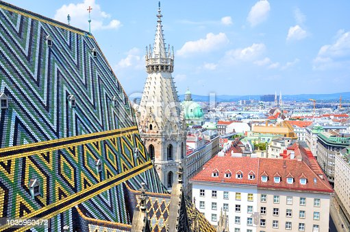 Fragment of colorful roof tiles mosaic. Stephansdom cathedral from its top in Vienna, Austria
