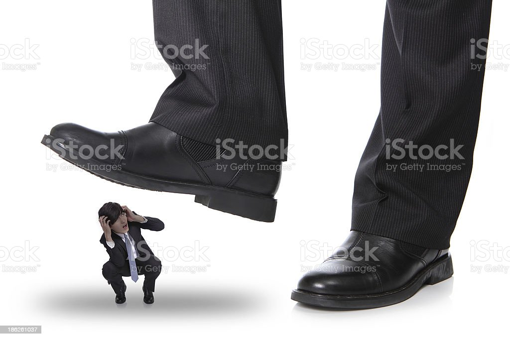 steping on a fear man stock photo