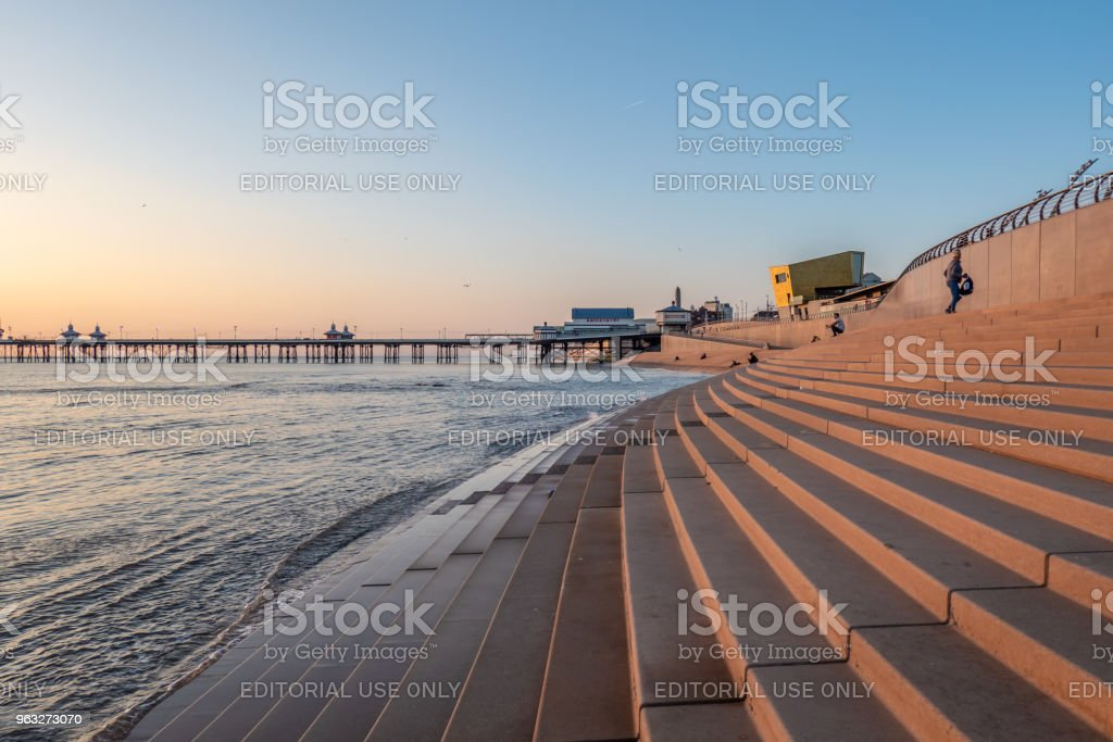 Stepped sea defences and pier on the coast of Blackpool stock photo