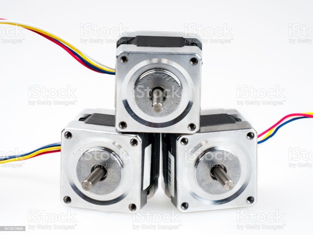 Stepper motors with wires and connectors, isolated on white stock photo
