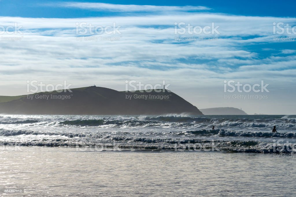 Stepper Point in silhouette from the adjacent Polzeath beach stock photo