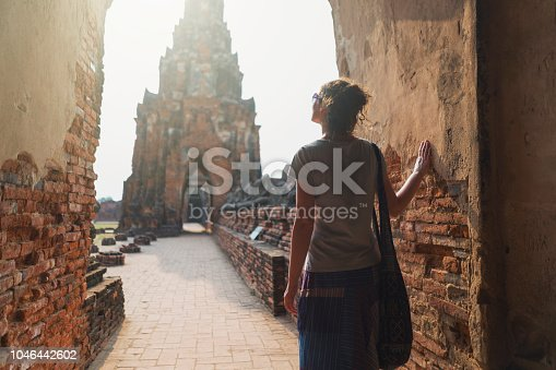 Caucasian female tourist sightseeing Ayuthaya historical park.