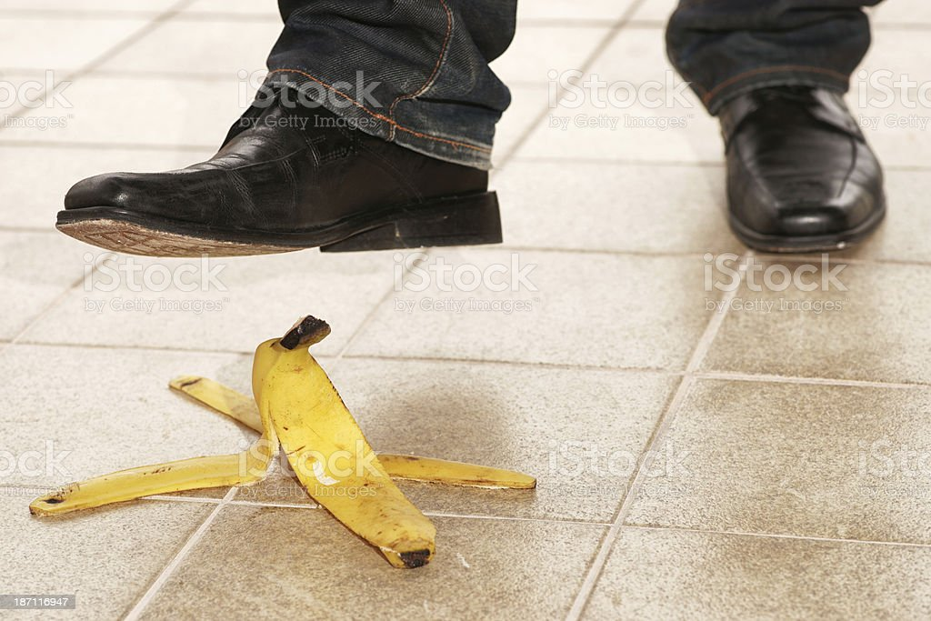 Stepping on banana peel royalty-free stock photo