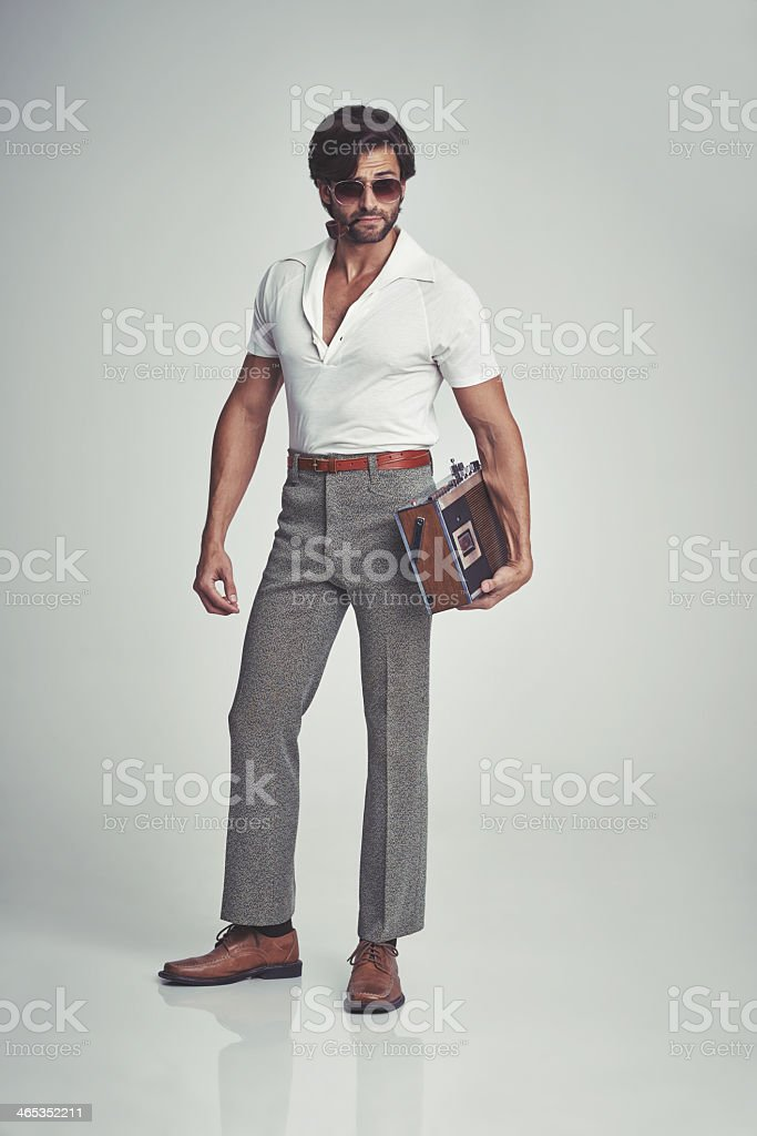 Stepping out with his tunes - 70s style! stock photo