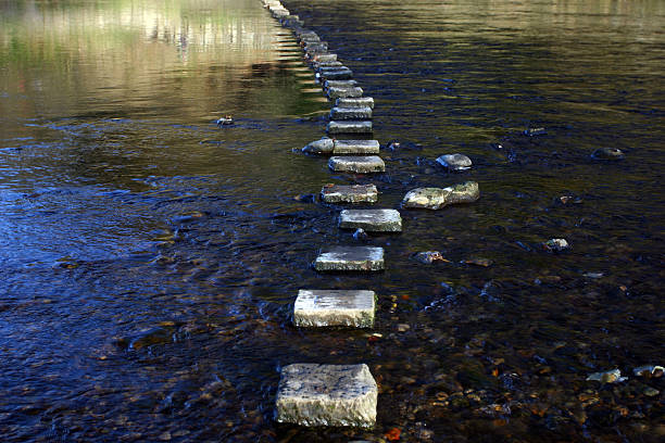 stepping stones across a river stepping stones across a river single step stock pictures, royalty-free photos & images