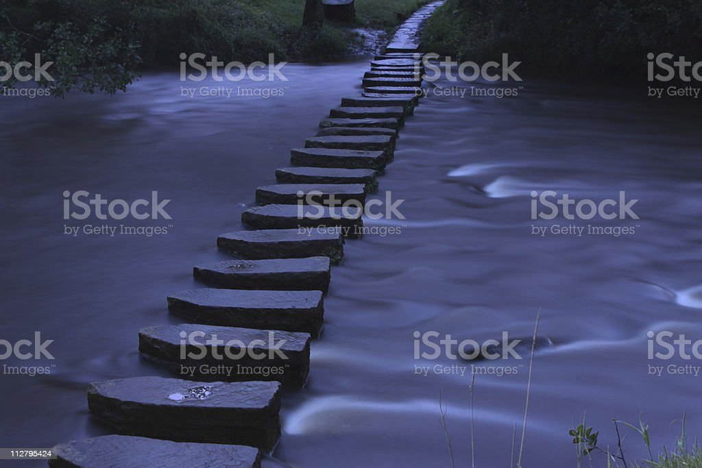 stepping stones at night stock photo