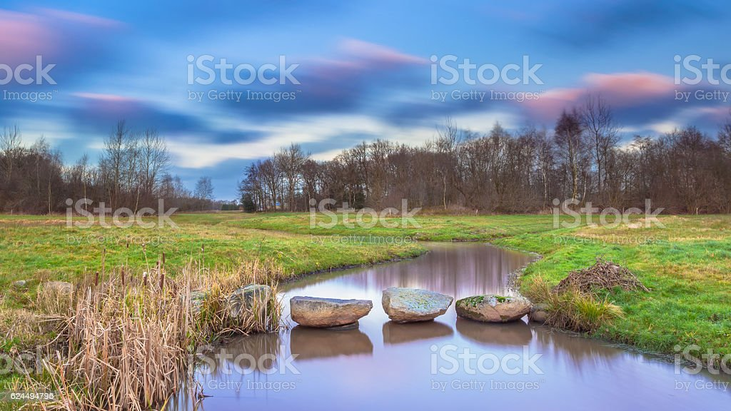 Stepping stones in river stock photo