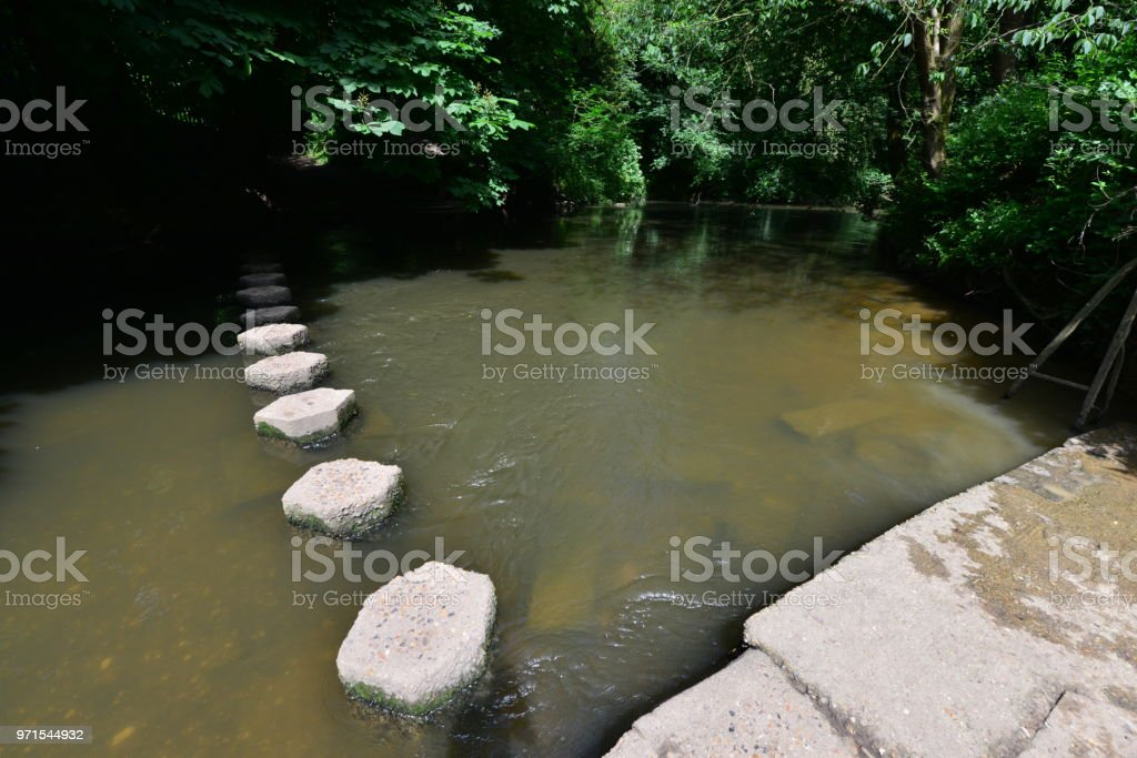 Stepping stones in the River Mole at Boxhill in Dorking, Surrey, stock photo