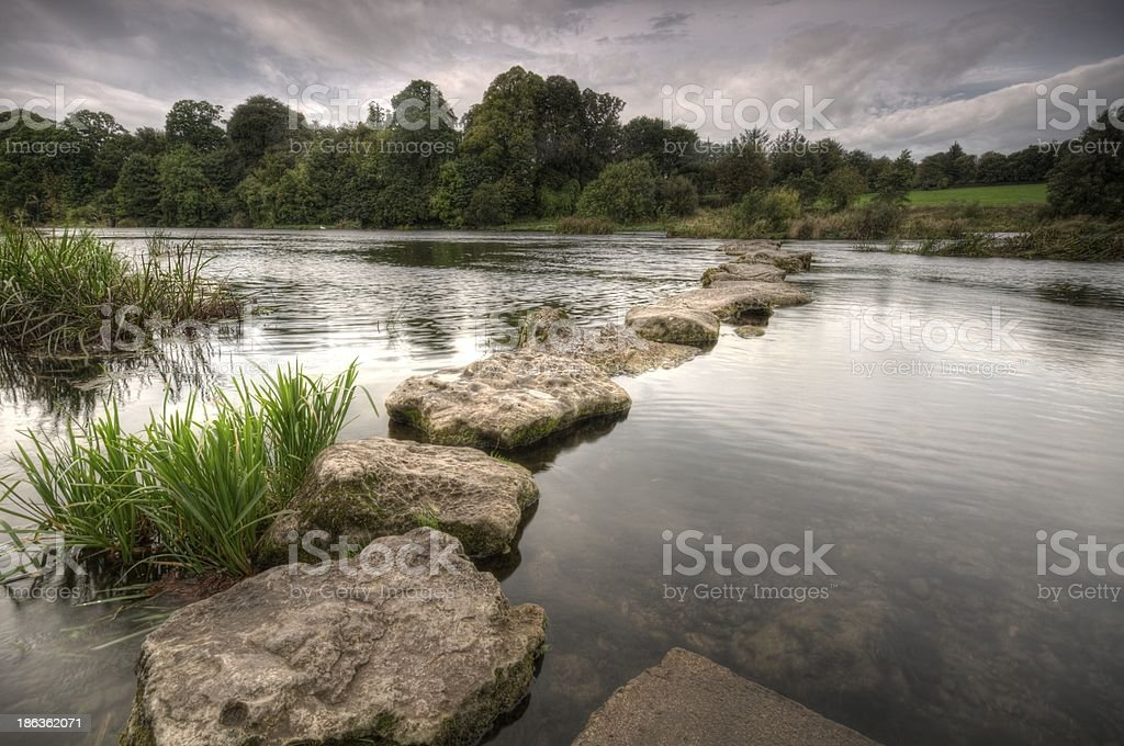 Stepping stones making a pathway in a pond stock photo