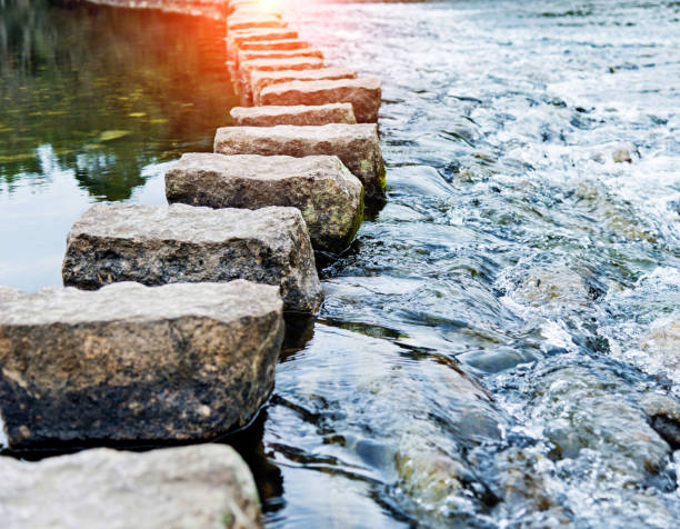 stepping stones on the water - walkway and bridge stock photos and pictures