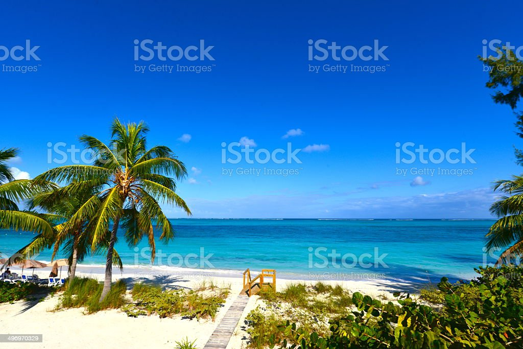 Steps at Grace Bay Beach in Turks and Caicos stock photo