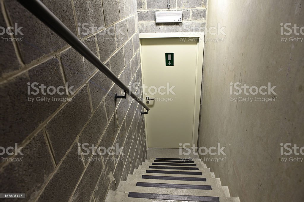 Steps down to exit in cellar basement stock photo