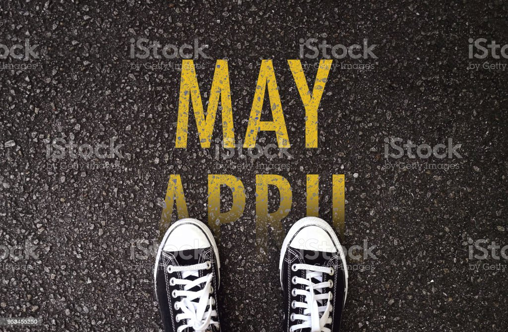 Steps forward to May on the road. stock photo