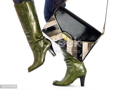 636803682 istock photo steps in fashion boots with bag on white 522424349