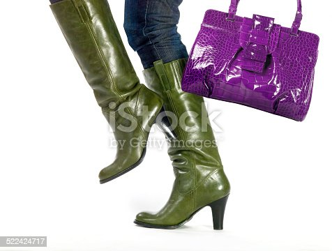 636803682 istock photo steps in fashion boots with bag on white 522424717