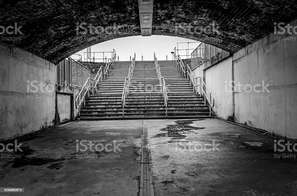 steps leading into a football ground, black and white image stock photo