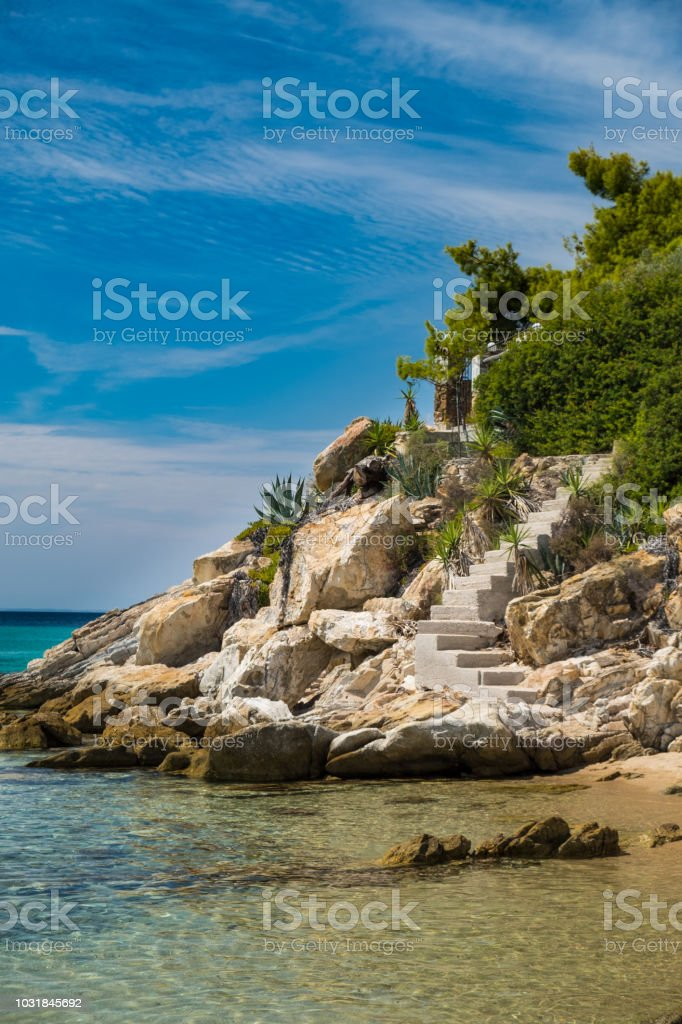 Steps leading to the private beach stock photo