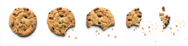 Steps of chocolate chip cookie being devoured. Isolated on white background. stock photo