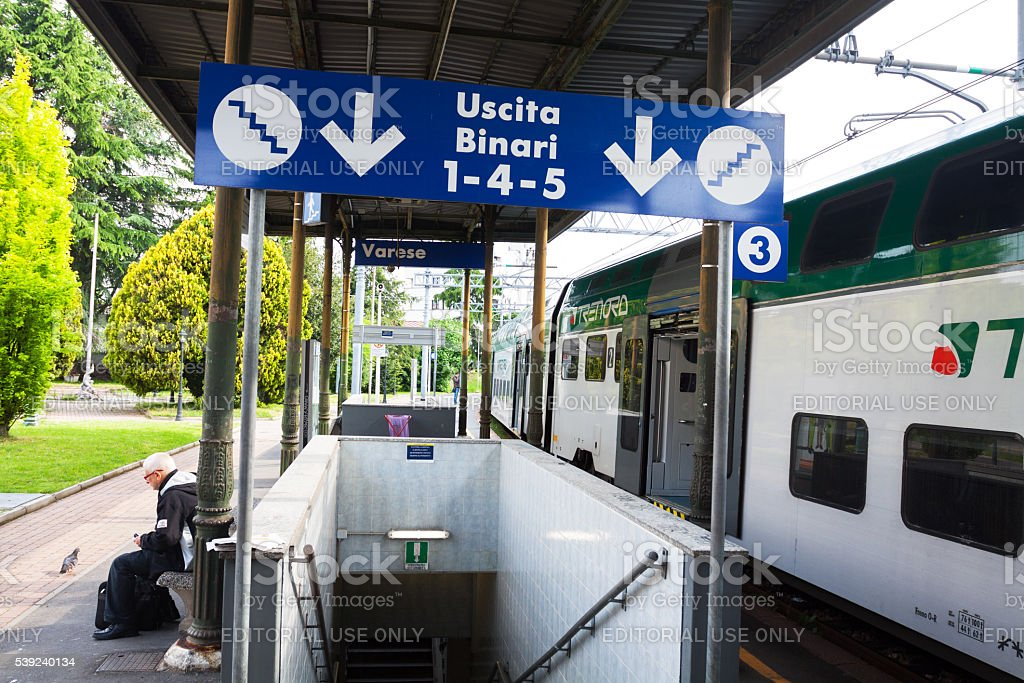 Steps, platform, a man and train in station Varese royalty-free stock photo