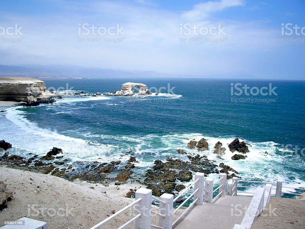 Steps to the coast with view of La Portada, Chile stock photo